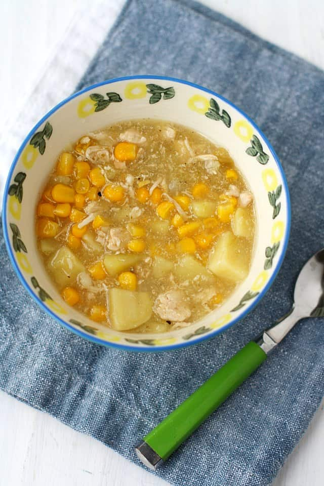 white chicken chili with corn in a white bowl
