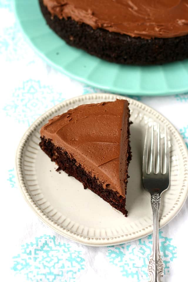 slice of vegan chocolate cake with icing