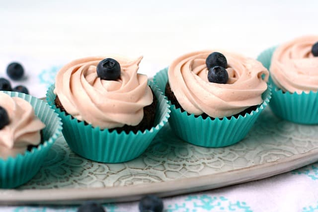 chocolate cupcakes with blueberry frosting