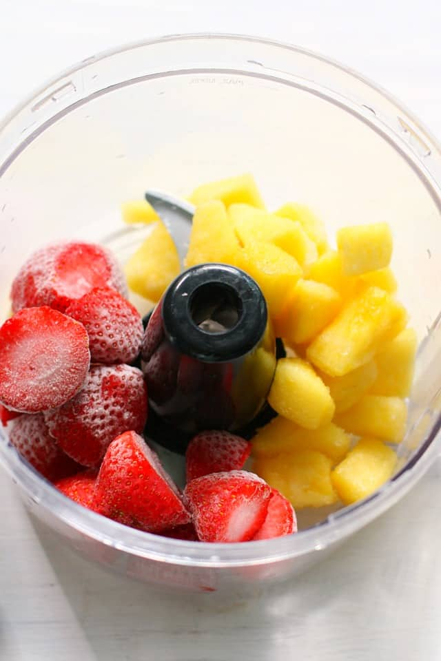 strawberries and pineapple in food processor