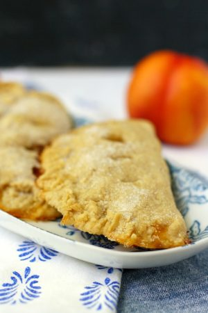 vegan peach hand pies on a floral plate