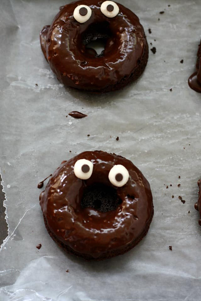 chocolate donuts with googly eyes
