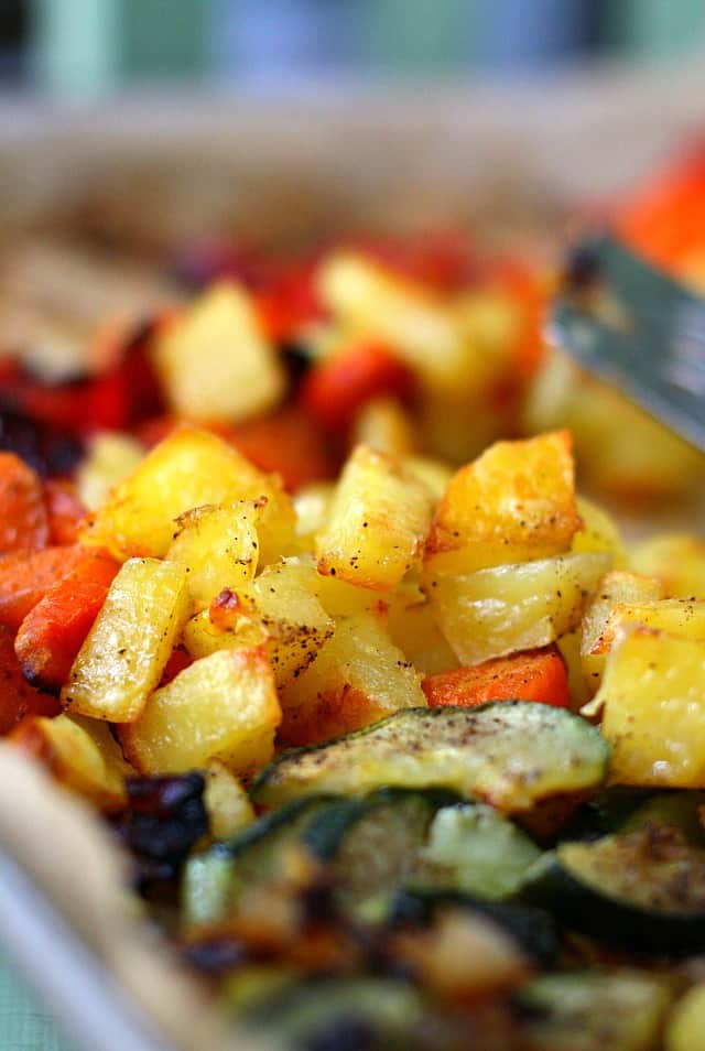 roasted potatoes and vegetables on a cookie sheet
