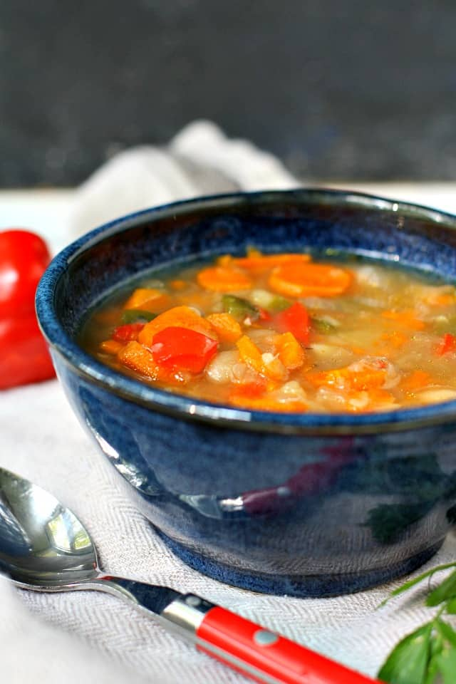 vegetable bean soup in a blue bowl