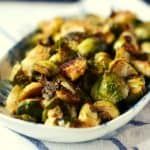 roasted brussels sprouts on a white platter