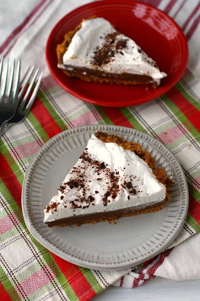 slices of dairy free chocolate silk pie on red and white plates
