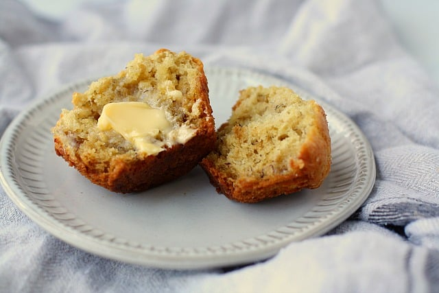 vegan banana muffin with butter on a grey plate