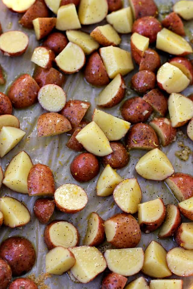 red potatoes on a cookie sheet with olive oil