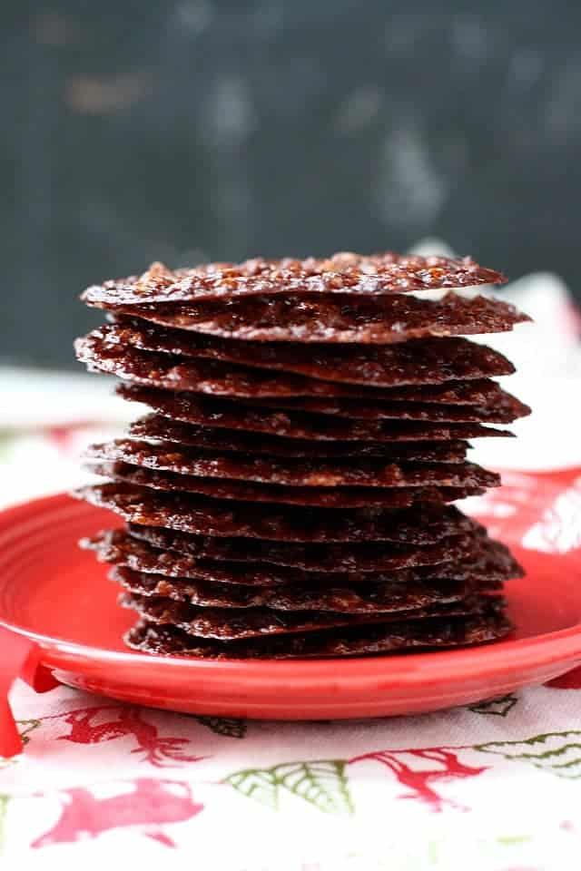 stack of chocolate lace cookies on a red plate