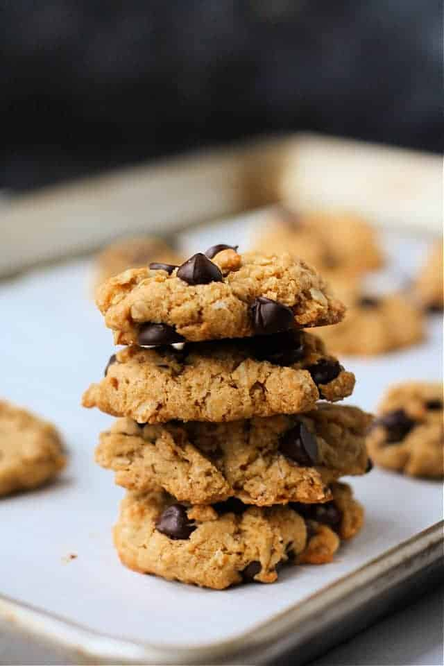 sweet potato oatmeal cookies stacked on a cookie sheet