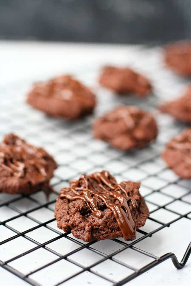 gluten free chocolate brownie cookies on a cooling rack