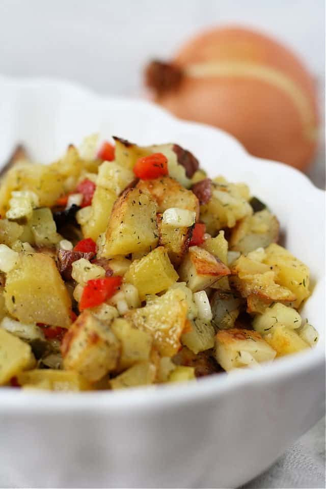 dill potato salad with no mayo in a white bowl