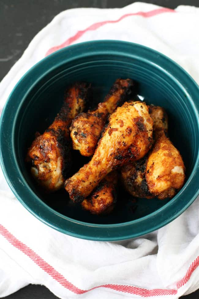 grilled chicken legs with spice rub in a serving bowl