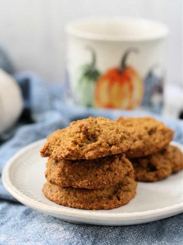 pumpkin spice oat flour cookies on a white plate