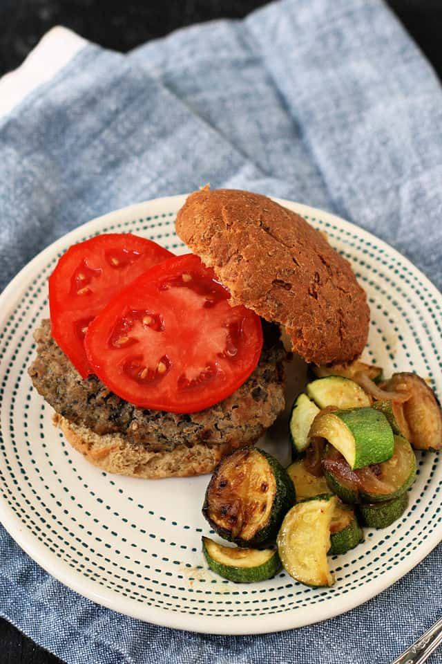 turkey burger topped with tomato