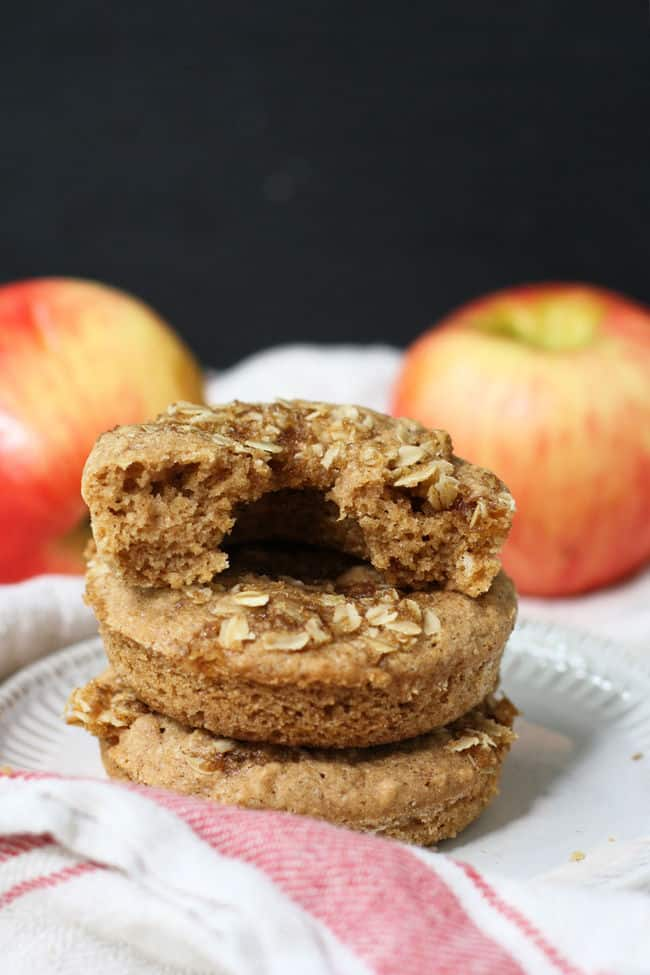 streusel donuts with apples in the background