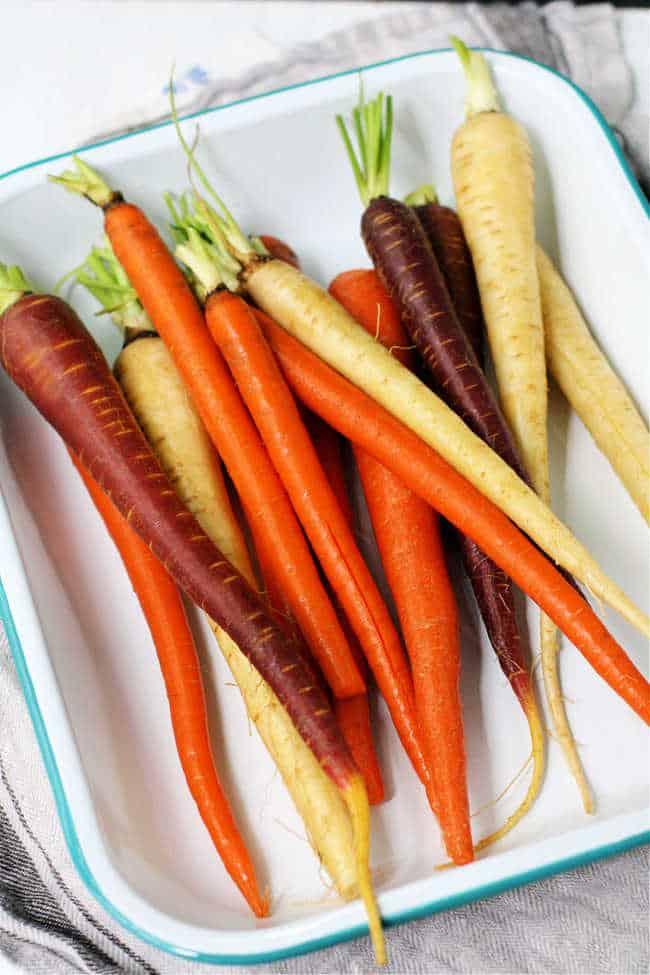 rainbow carrots in an enamel dish