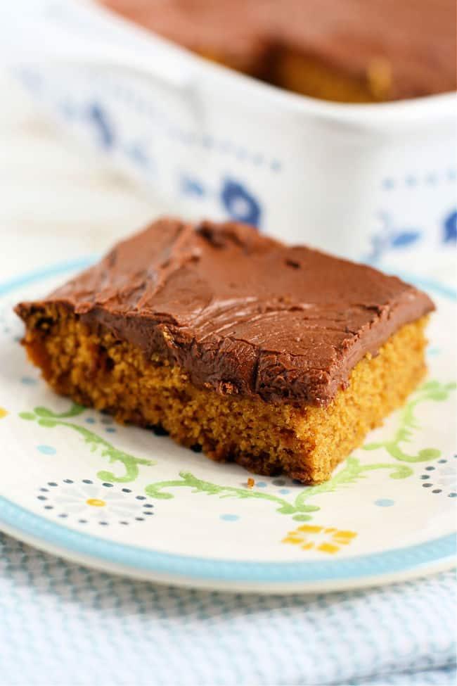 slice of gluten free vegan pumpkin cake on a small plate
